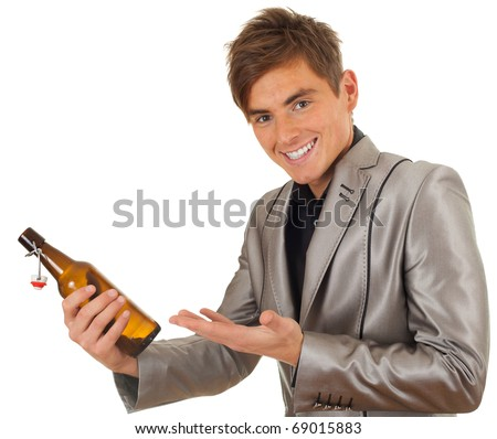 standing happy young man in grey suit with bottle of beer