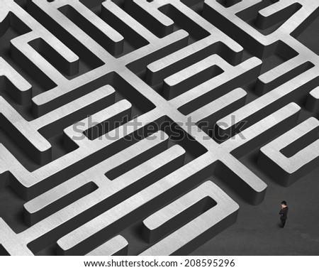 Standing in front of huge 3D concrete maze
