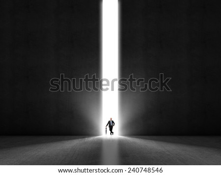 standing man and abstract huge gate - stock photo
