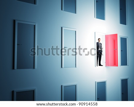 standing man and 3d doors - stock photo