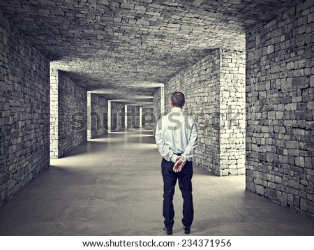 standing man and 3d stone tunnel - stock photo