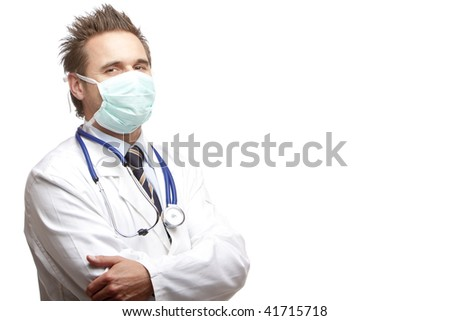 Standing medical doctor with mask and stethoscope looks self confident into camera. Isolated on white. - stock photo