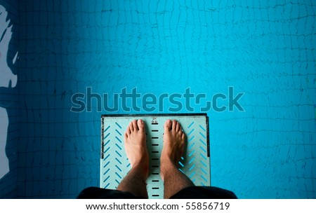 standing on springboard - stock photo