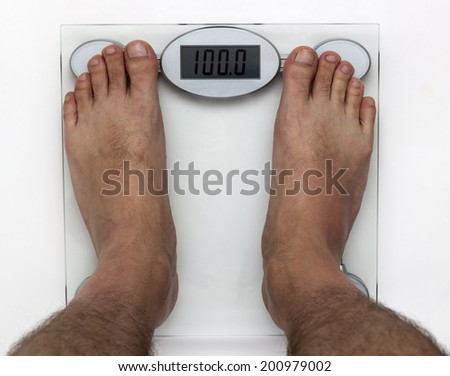 standing on the scales - stock photo
