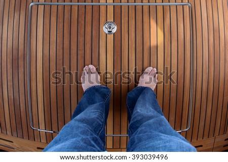 Standing on wooden boat floor - stock photo