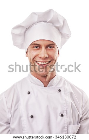 standing smiling male cook in white uniform and hat, isolated on white