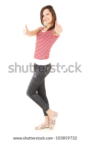 standing teenage woman with thumbs up, full length, white background - stock photo