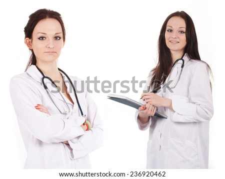 Standing woman doctor with stethoscope in a white robe. She stands folding her arms - stock photo