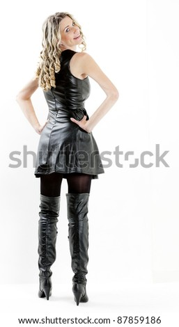 standing woman wearing black dress and black boots