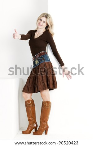 standing woman wearing brown boots - stock photo