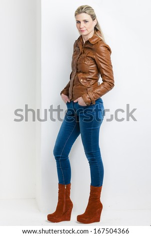 standing woman wearing fashionable platform brown shoes - stock photo