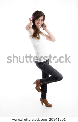 standing woman with cell phone wishing good luck with white background - stock photo