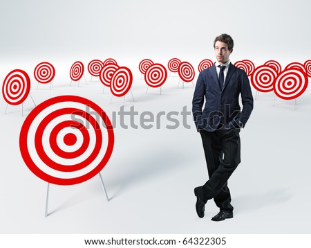standing young businessman and 3d target - stock photo