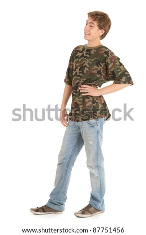 standing young man in casual jacket with hands in pocket, full length - stock photo