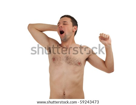standing young man yawning and stretching, isolated - stock photo