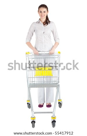 standing young woman with empty shopping cart - stock photo