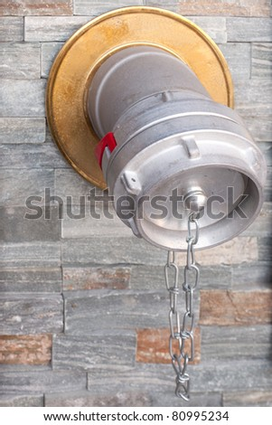 Standpipe connection to fire sprinkler system in public building. - stock photo