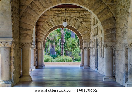 STANFORD, CA/USA - JULY 6: Original walls at Stanford University.  The historic university features sandstone walls with thick Romanesque features. July 6, 2013. - stock photo