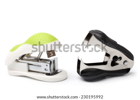 Stapler and staple remover on white background - stock photo