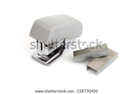 Stapler with staples wires on white background. - stock photo