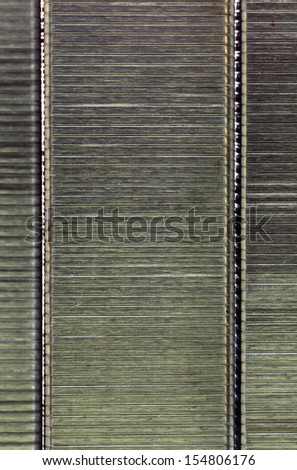 Staples metal grey texture background  - stock photo
