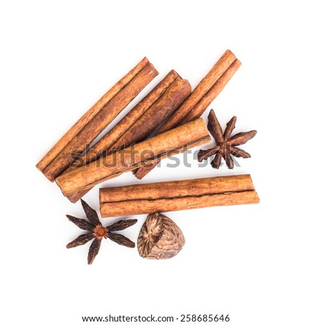 star anise cinnamon and nutmeg isolated on white background - stock photo