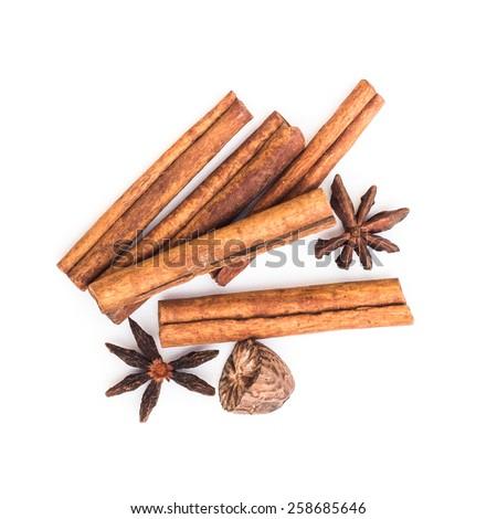 star anise cinnamon and nutmeg isolated on white background - stock photo