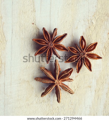 Star anise closeup on wooden table - stock photo