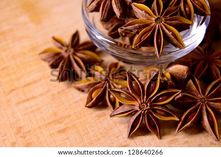 Star Anise in the Glass Bowl on the Wooden Table - stock photo