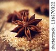 Star Anise on Brown Sugar - stock photo