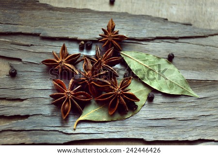Star anise on dark wooden background, close-up - stock photo