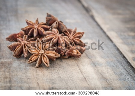 Star anise on wooden table - stock photo