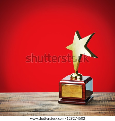 star award with space for text on a red background - stock photo