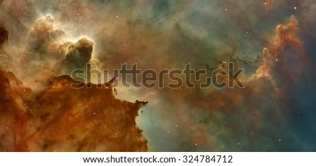 Star Birth in the Carina Nebula (Grand Nebula). Large bright nebula that has within its boundaries several related open clusters of stars. Retouched image. Elements of this image furnished by NASA. - stock photo