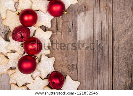 Star Christmas cookies and ornaments on wooden background - stock photo