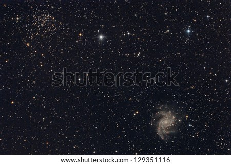 star cluster and galaxy - stock photo