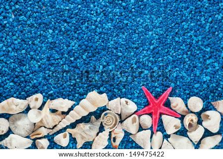Star-fish and seashells on sand, centered, symmetric - stock photo