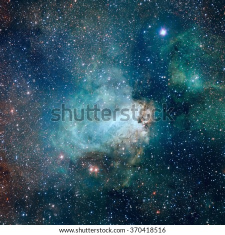 Star-forming region Messier 17, also known as the Omega Nebula or the Swan Nebula. This vast region of gas, dust and hot young stars lies in Milky Way. Elements of this image furnished by NASA. - stock photo