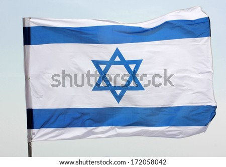 Star of David on a blue and white Israeli flag - stock photo