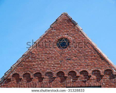 Star of David on an old house - symbol of Judaism - stock photo