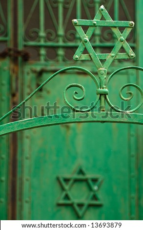 Star of david on an old synagogue gate - stock photo