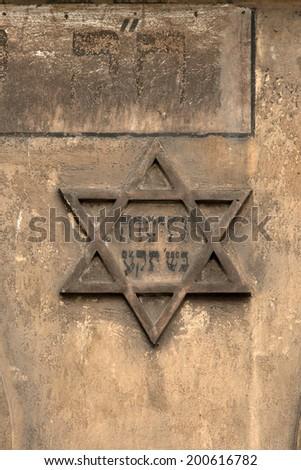 Star of David on the wall of historic Jewish Kazimierz district, Krakow - stock photo