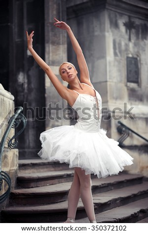 Star of the troupe. Cropped shot of a gorgeous ballet dancer posing outdoors  - stock photo