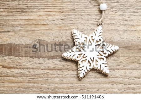 Star on wooden background, copy space