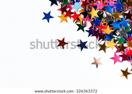 Star-shaped confetti on white background close-up