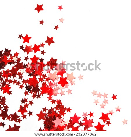 star shaped red confetti on white background. festive background - stock photo
