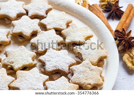 Star shaped walnut linzer cookies filled with plum jam.