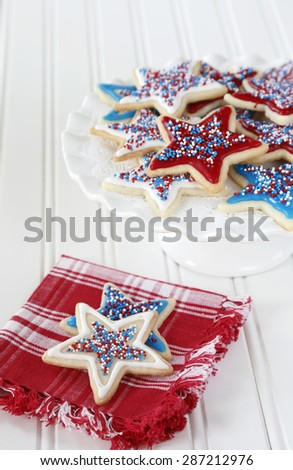 Star sugar cookies decorated with icing and sprikles in red, blue, and white for the 4th of July celebration in America. - stock photo