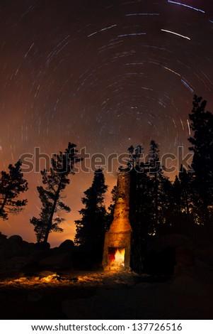 Star Trails and Campfire at Chimney Beach, Lake Tahoe, Nevada - stock photo