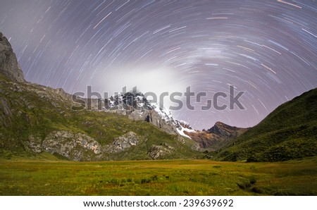 Star Trails and Smooth Clouds over the Cordillera Huayhuash, Peru - stock photo